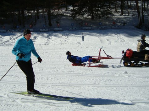 "Janet narrowly avoids the ""Groomer Surfing"" punks of Saratoga Biathlon Club"