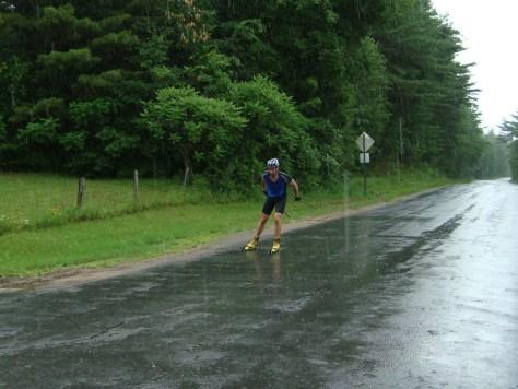 a soggy Moffett heads towards the finish